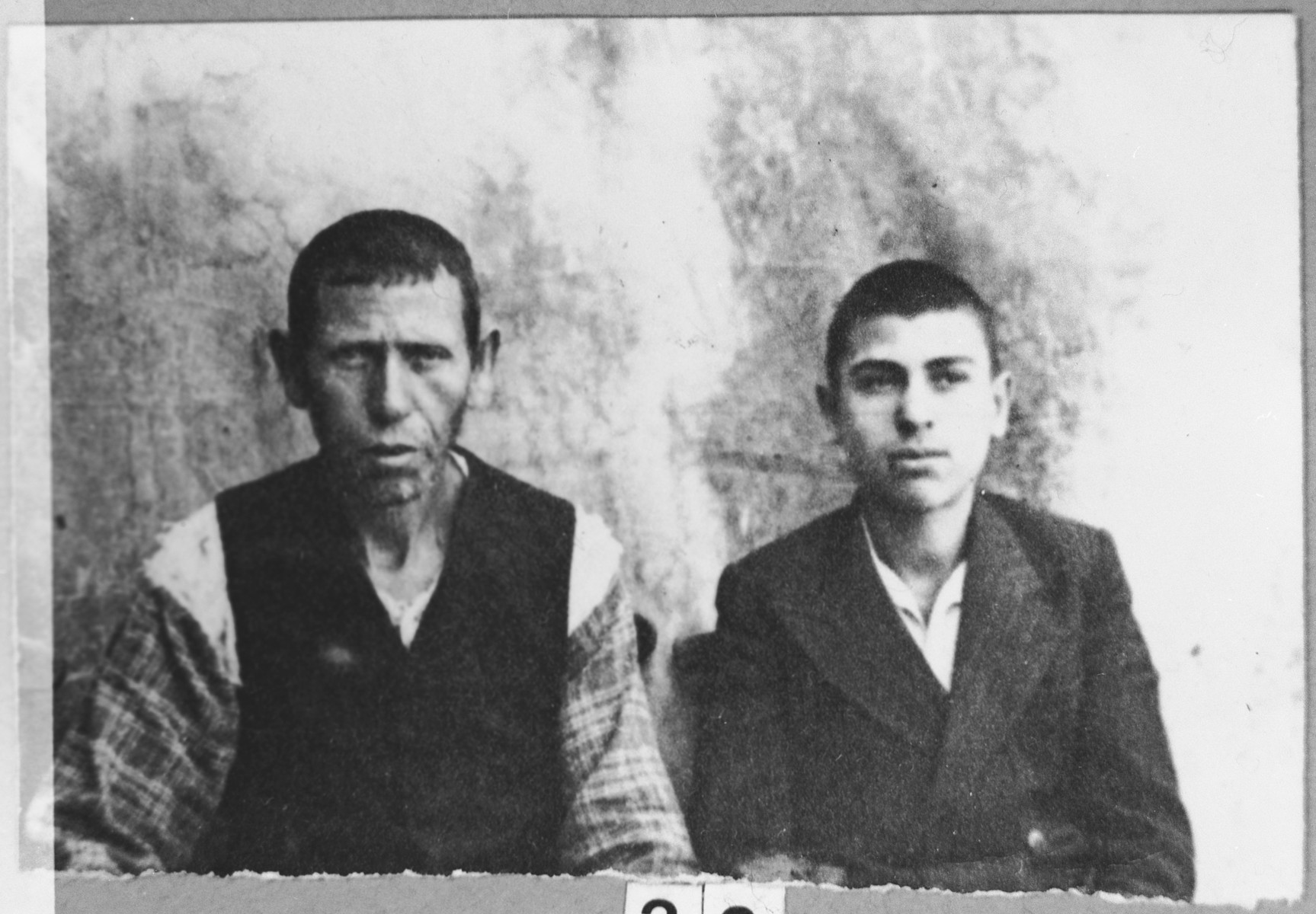 Portrait of Aron Albocher, son of Shabetai Albocher, and his son, Yakov.  Aron was a laborer and Yakov, a student.  They lived at Krstitsa 12 in Bitola.