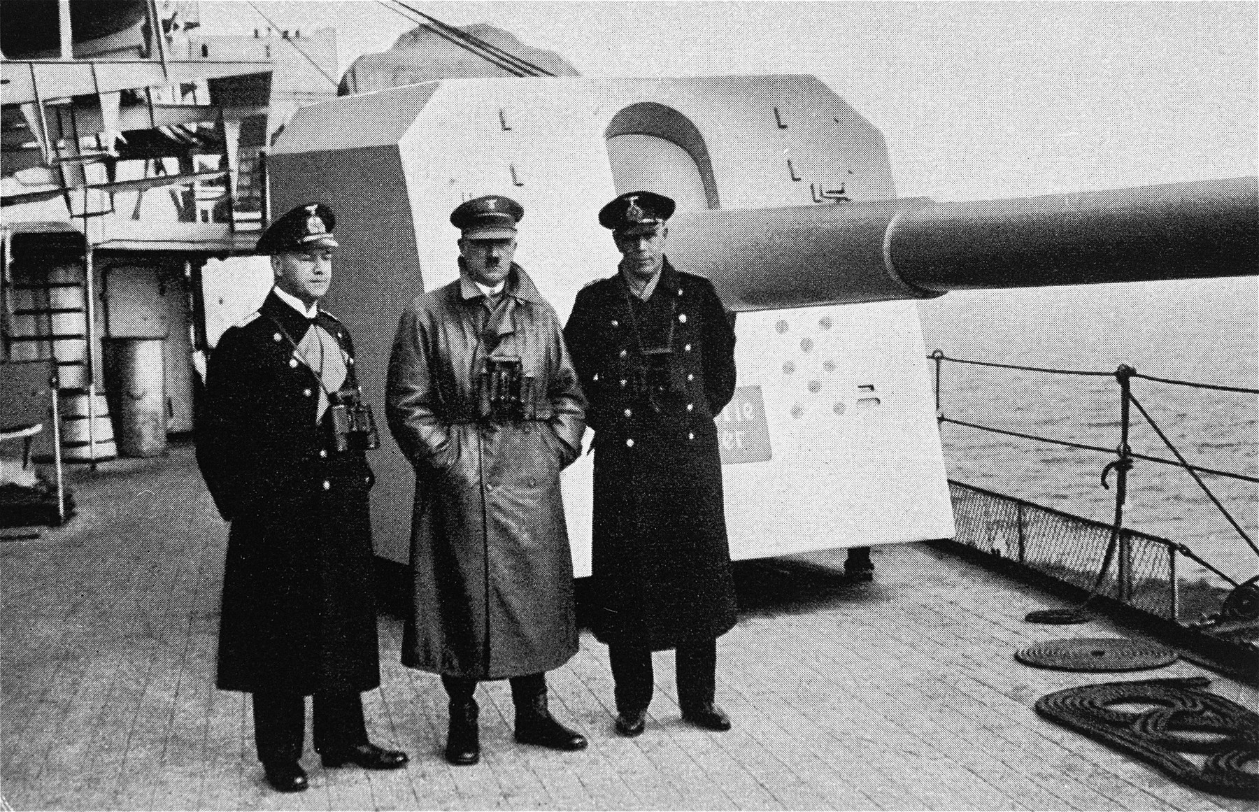 Hitler inspects a German naval warship [perhaps the Deutschland].   To his left is Admiral Erich Raeder.  On the right is most probably,  Captain Hermann v. Fischel, commander of the Deutschland from 01 Apr 1933 to 29 Dec 1935.
