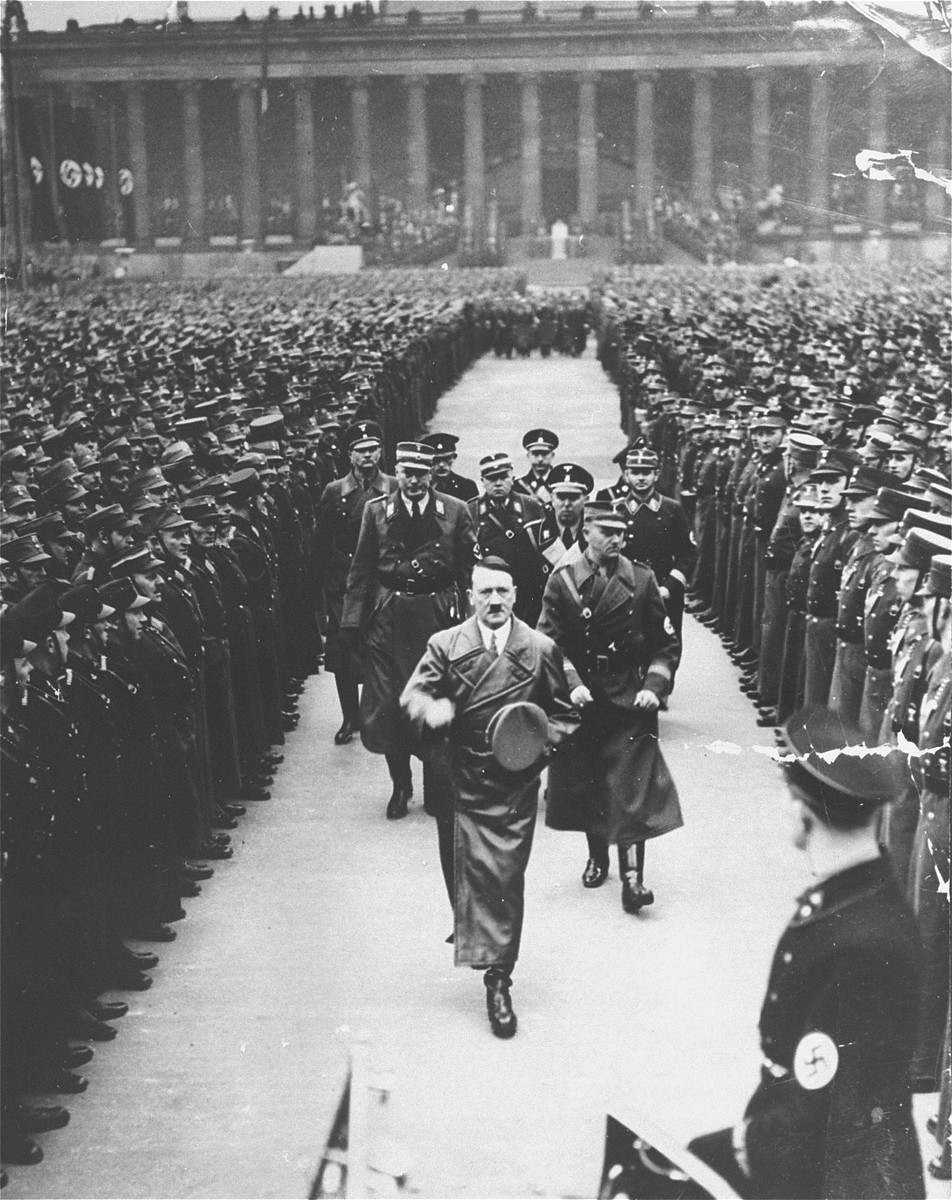 Adolf Hitler walks to his car after addressing an SA rally in the Berlin Lustgarten, convened to celebrate the third anniversary of his chancellorship.