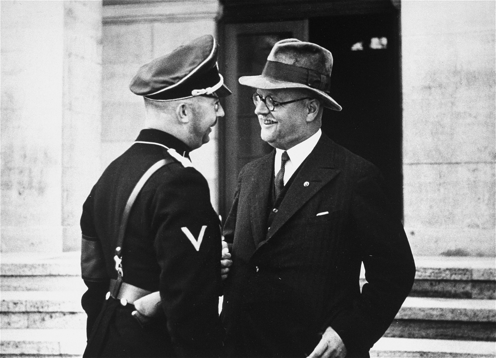 Heinrich Himmler on an official inspection, is greeted by Franz Xaver Schwarz.  This image is from an album of SS photographs.
