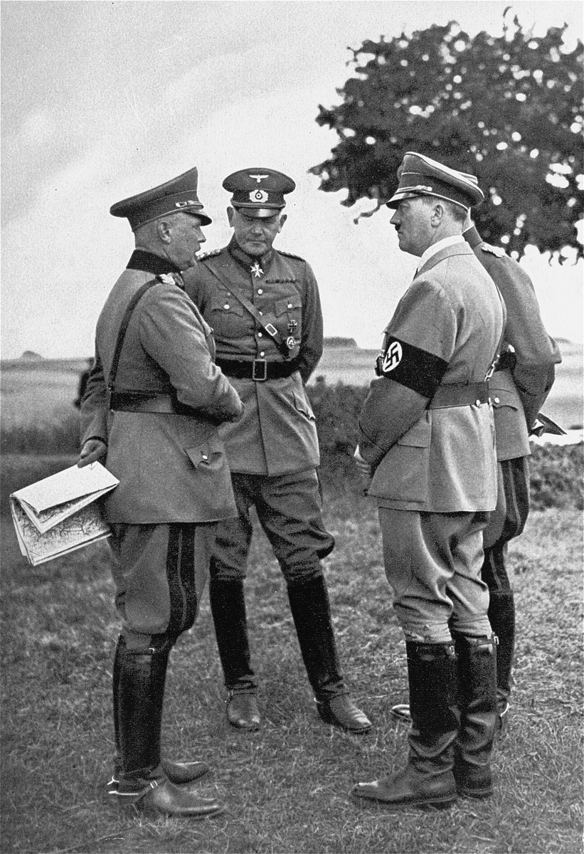 Hitler with the Minister of War Werner von Blomberg and Werner von Fritsch, commander-in-chief of the army, during army maneuvers at the Munster training camp.