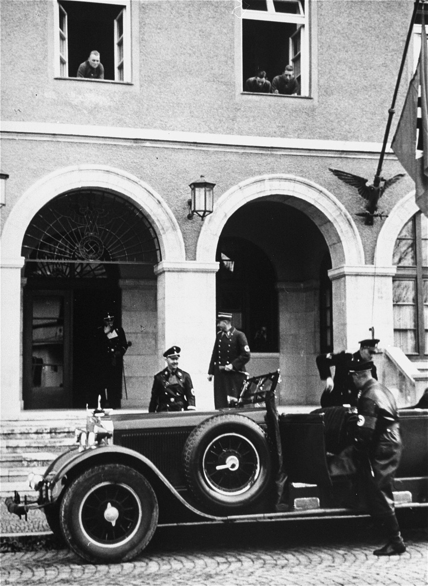 Heinrich Himmler walks to his car.  This image is from an album of SS photographs.