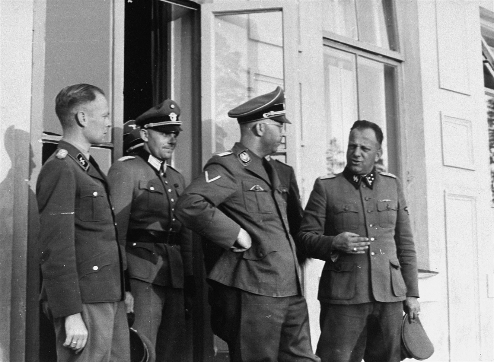 Heinrich Himmler with other Nazi officials.  [Also pictured are probably Walther Hewel and Otto Guensche.]