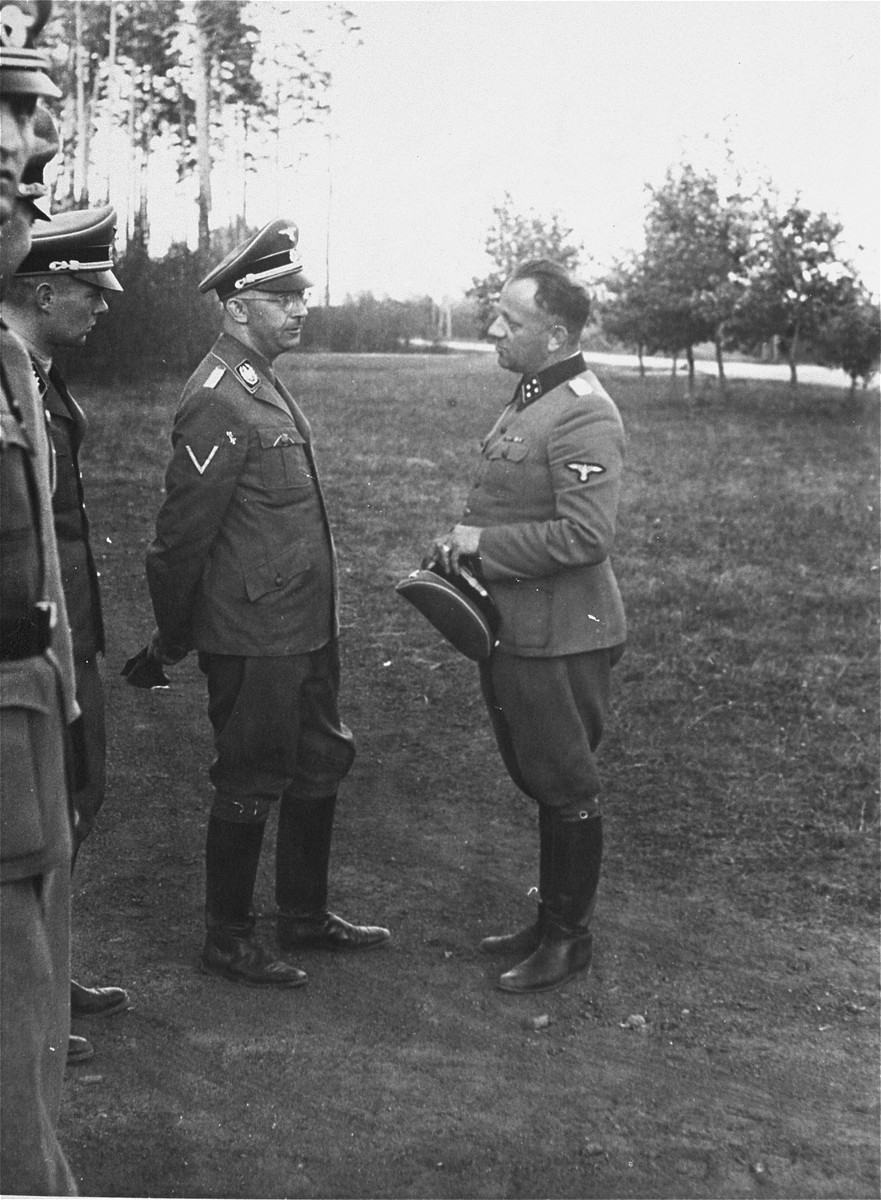 Heinrich Himmler meets with other Nazi officials.