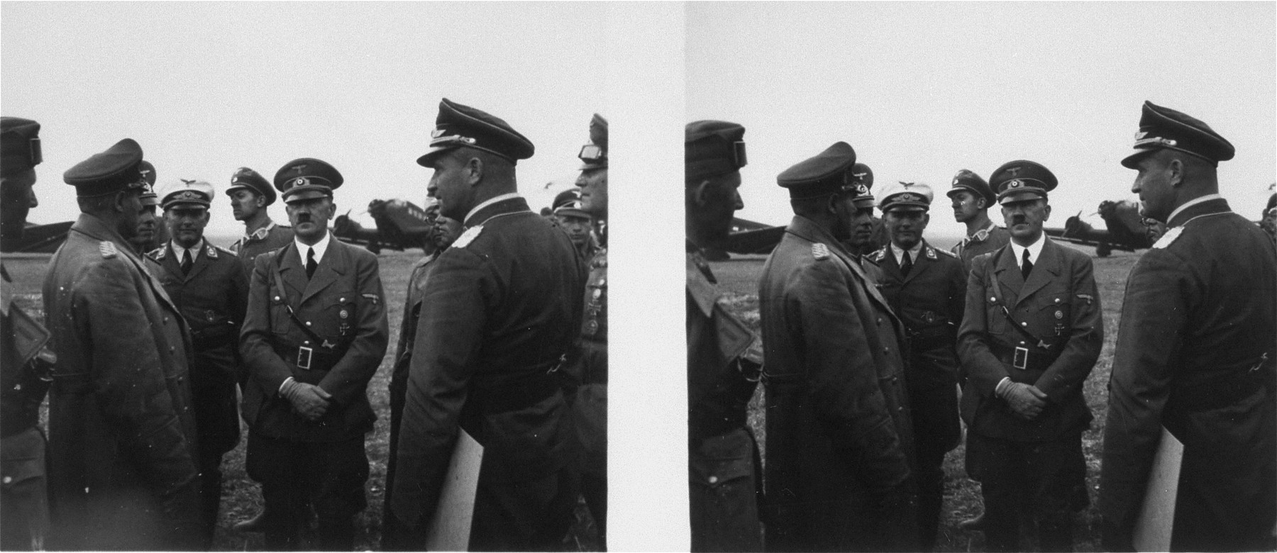 Stereoscopic photograph of Adolf Hitler on the landing field at Oppeln with a military entourage after a visit to the Polish front.