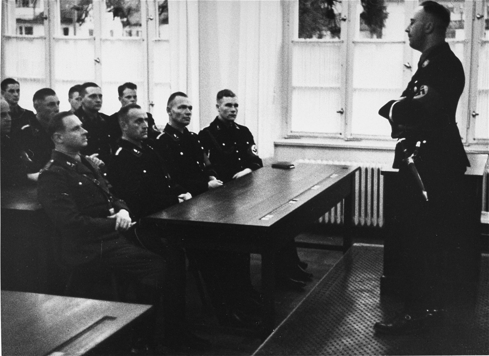 Heinrich Himmler lectures SS officers.  This image is from an album of SS photographs.