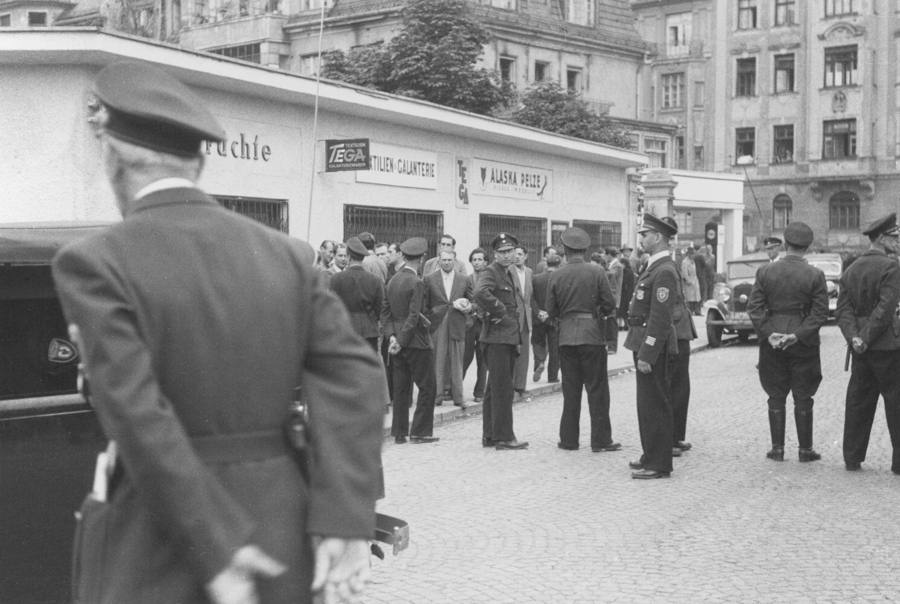 German police block off a commercial street in Munich after a raid on Jewish black-market activities resulted in a counter-demonstration by Jewish shopkeepers who closed their stores.