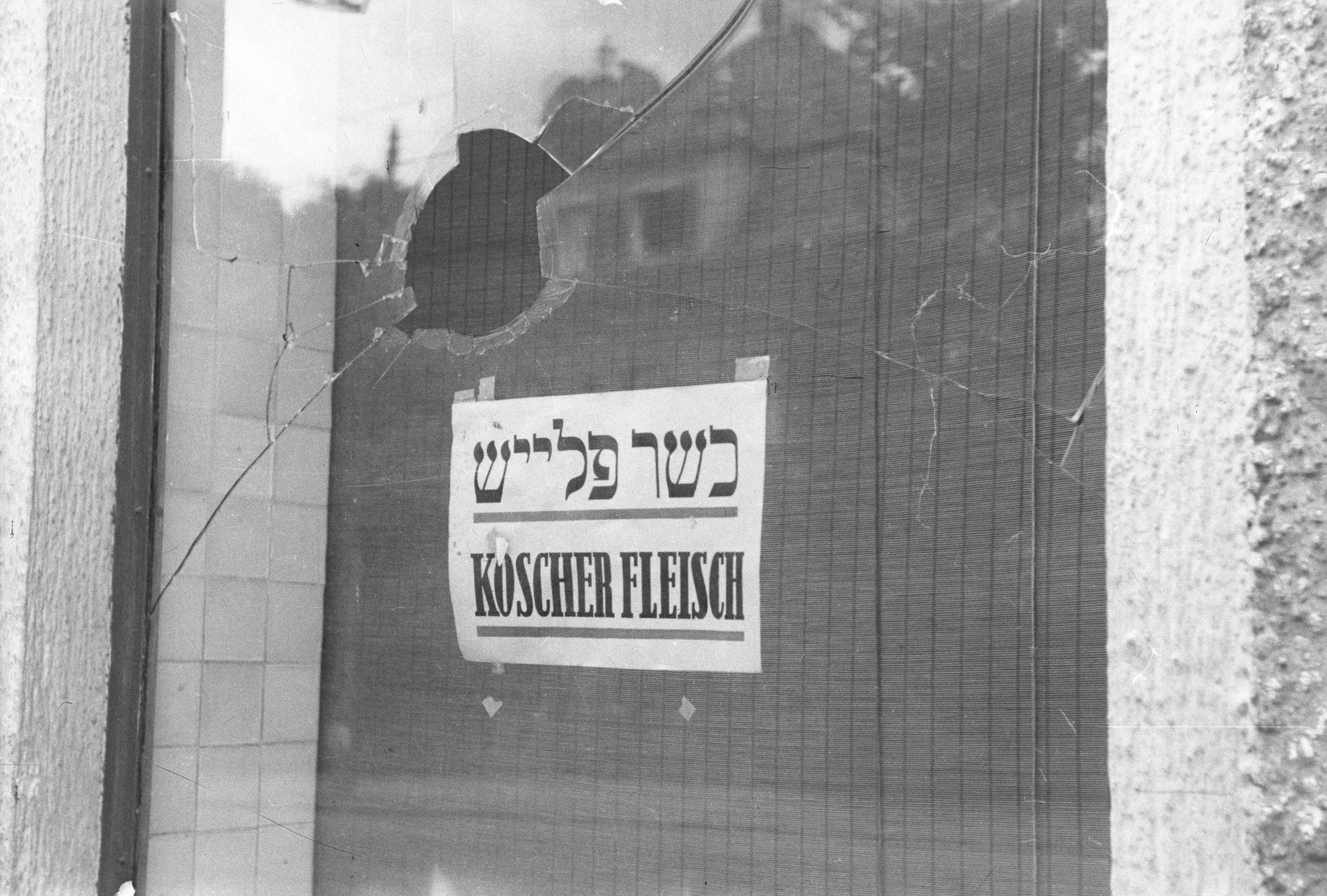 The vandalized display window of a kosher butcher shop located on the Ismaningerstrasse in Munich.