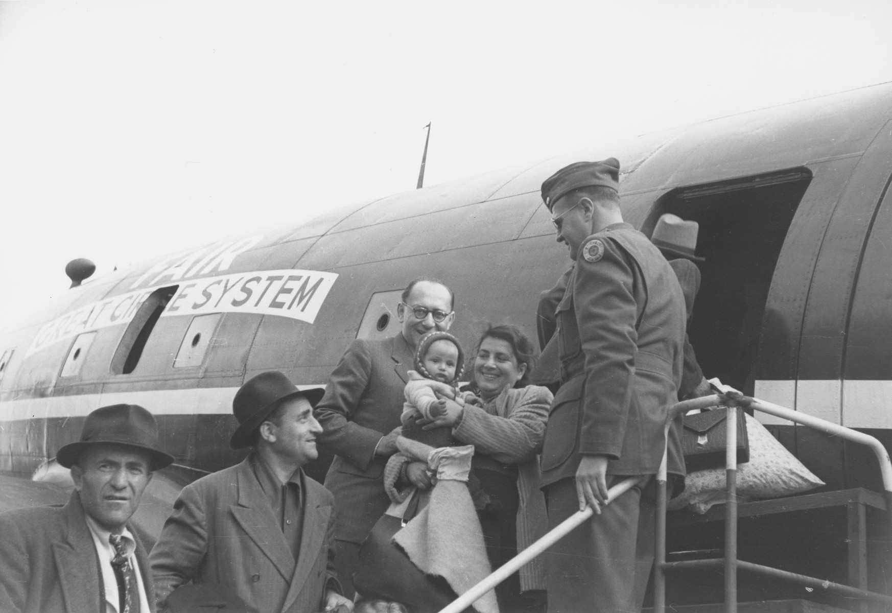 Israeli emissary Barzelai greets Jewish DPs as they board the first air transport of new immigrants to Israel from Germany.