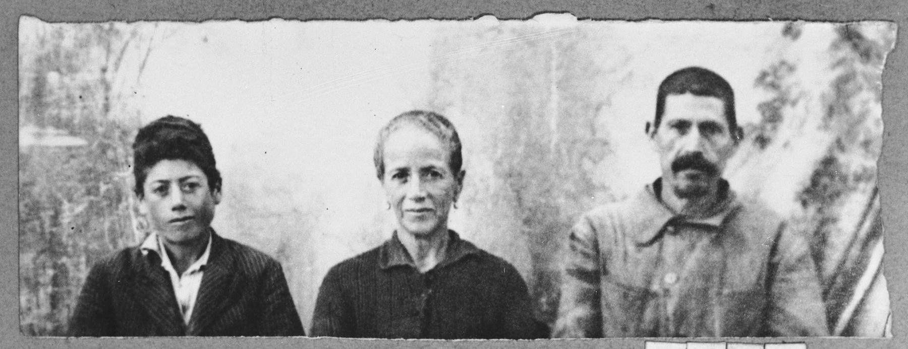 Portrait of Yakov Hasson, his wife, Ester, and his son, Shalom.  Yakov was a porter and Shalom, a student.  They lived on Putnika in Bitola.
