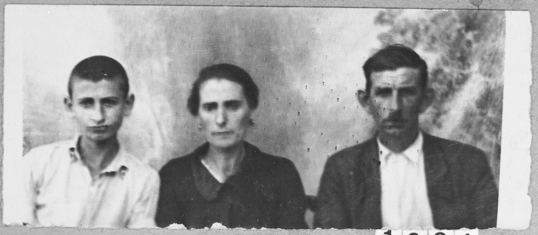 Portrait of Rachamin Hasson, his wife, Lea, and his son, David.  Rachamin was a rag dealer and David, a student.  They lived at Davidova 13 in Bitola.