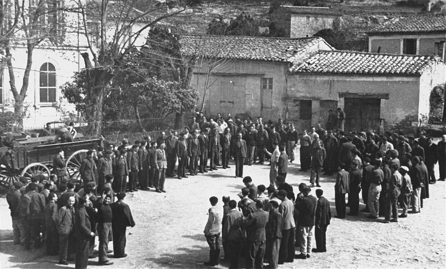 Roll call at the forced labor camp for Prestataires (foreign nationals drafted into a special branch of the French military).