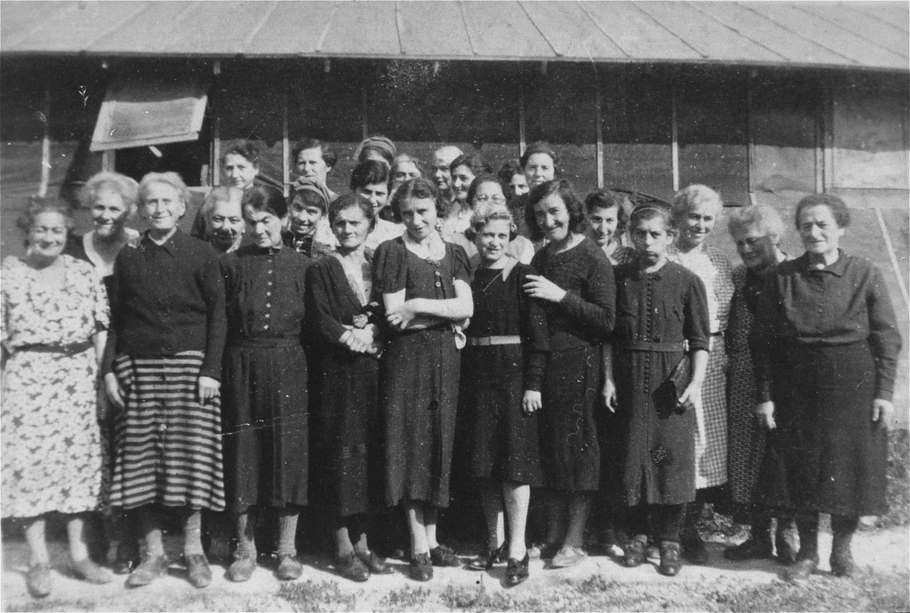 A group of female prisoners pose in front of a barracks in Ilot M at Gurs.   Among those pictured are Julie Bickard Rothschild  (1887-1946) from Altdorf, a relative of the donor, Hanna Meyer-Moses.