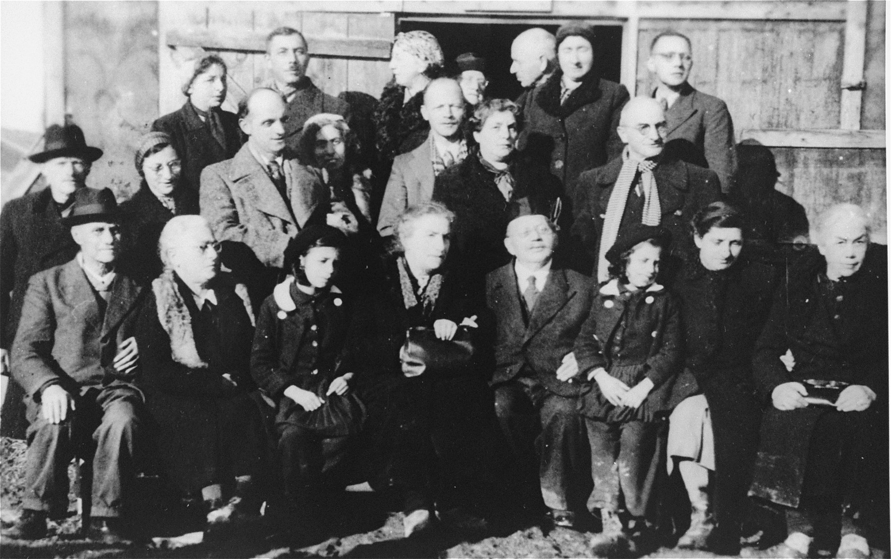 Group portrait of Jewish inmates in the Gurs internment camp taken on the occasion of the golden wedding anniverary of Julius and Emma Wachenheimer.