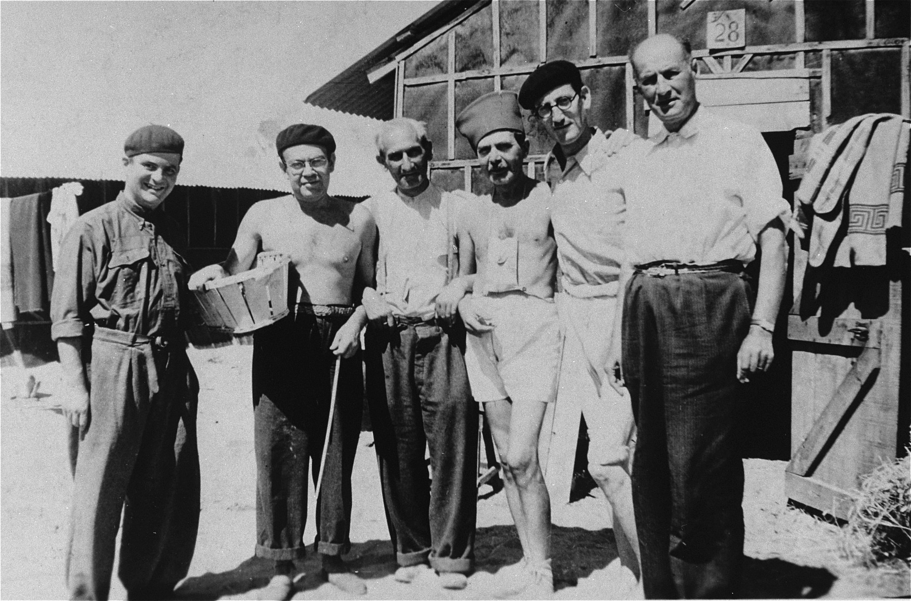Moritz Schoenberger (third from right) with other Jewish inmates in Saint Cyprien concentration camp.  Also pictured is Alexander Bornstein (far right).