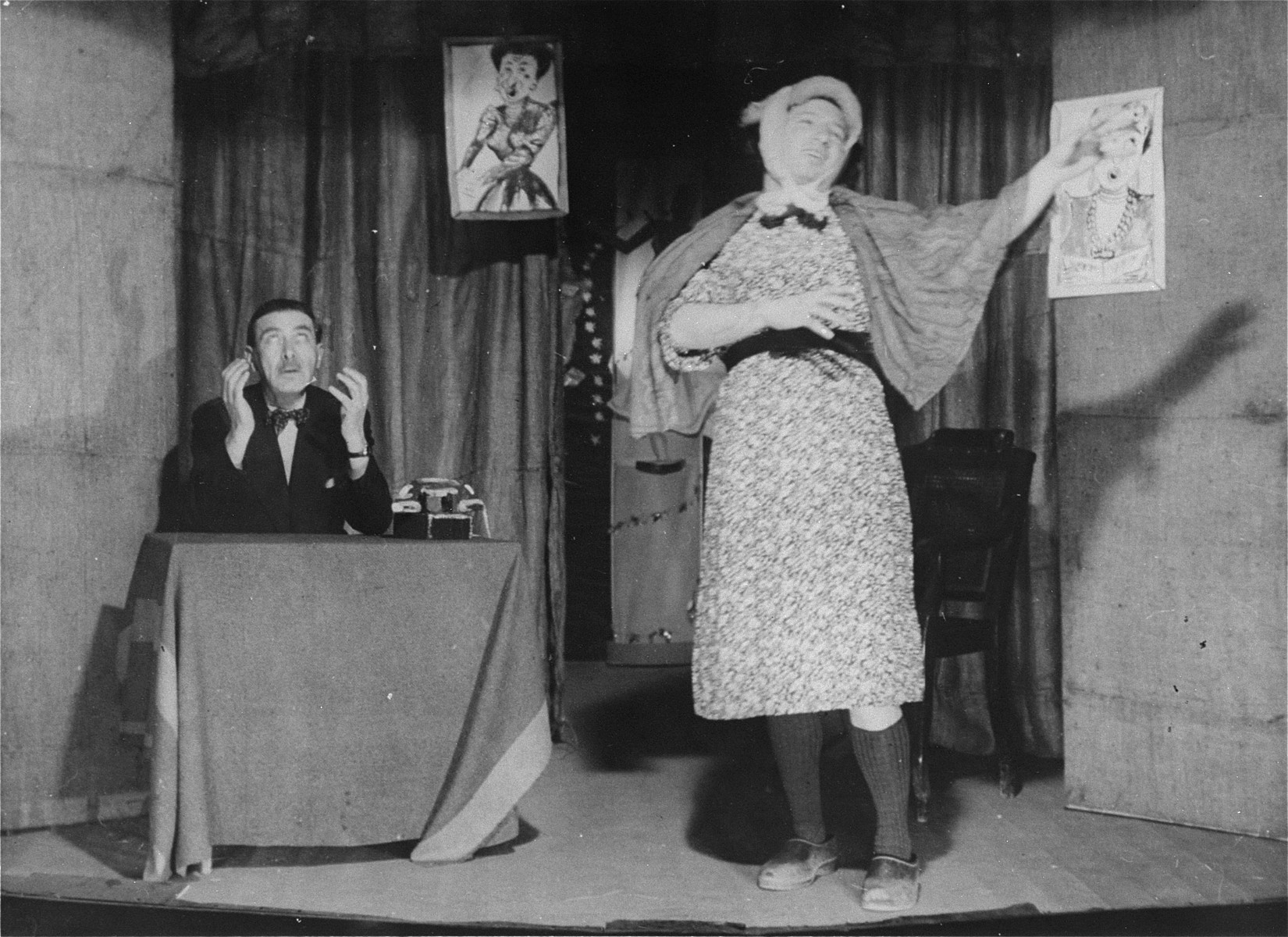 "Moritz Schoenberger (seated) in a production put on in the Les Milles concentration camp entitled ""The Lady Singer."""
