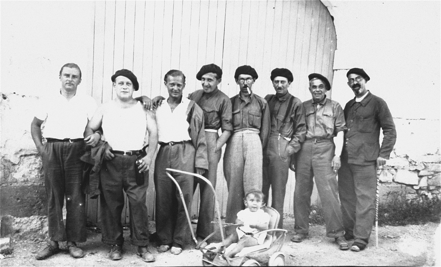 A group of Jewish refugees, conscripts in the Prestataires, a branch of the French military reserved for foreign nationals, in Langlade labor camp.  The man fourth from right is Hugo Rappaport.
