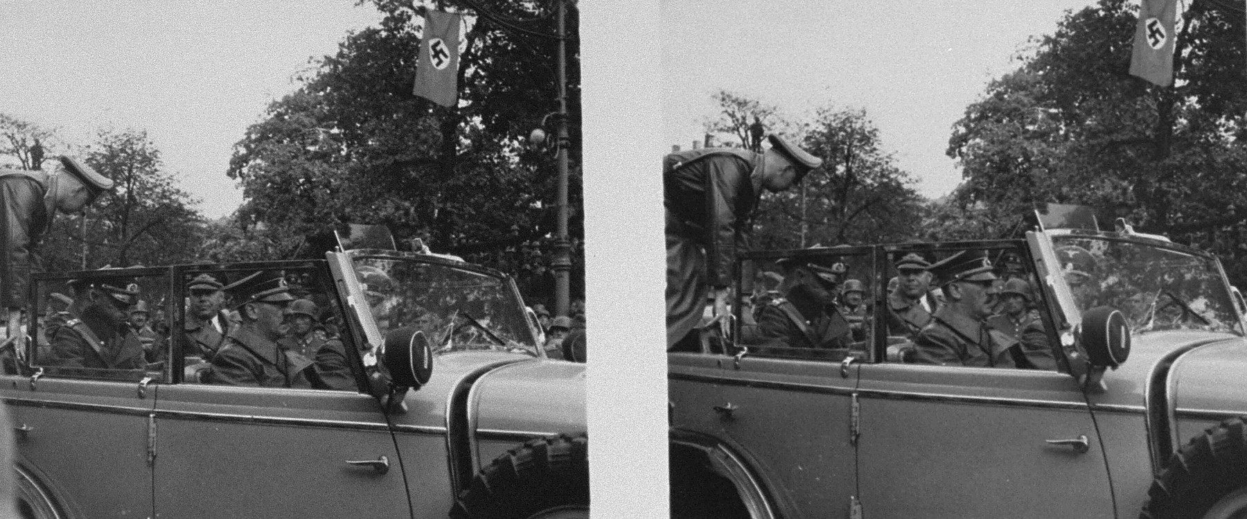 Stereoscopic photograph of Adolf Hitler and other Nazi officials leaving the viewing stand following a victory parade in Warsaw celebrating the German conquest of Poland.
