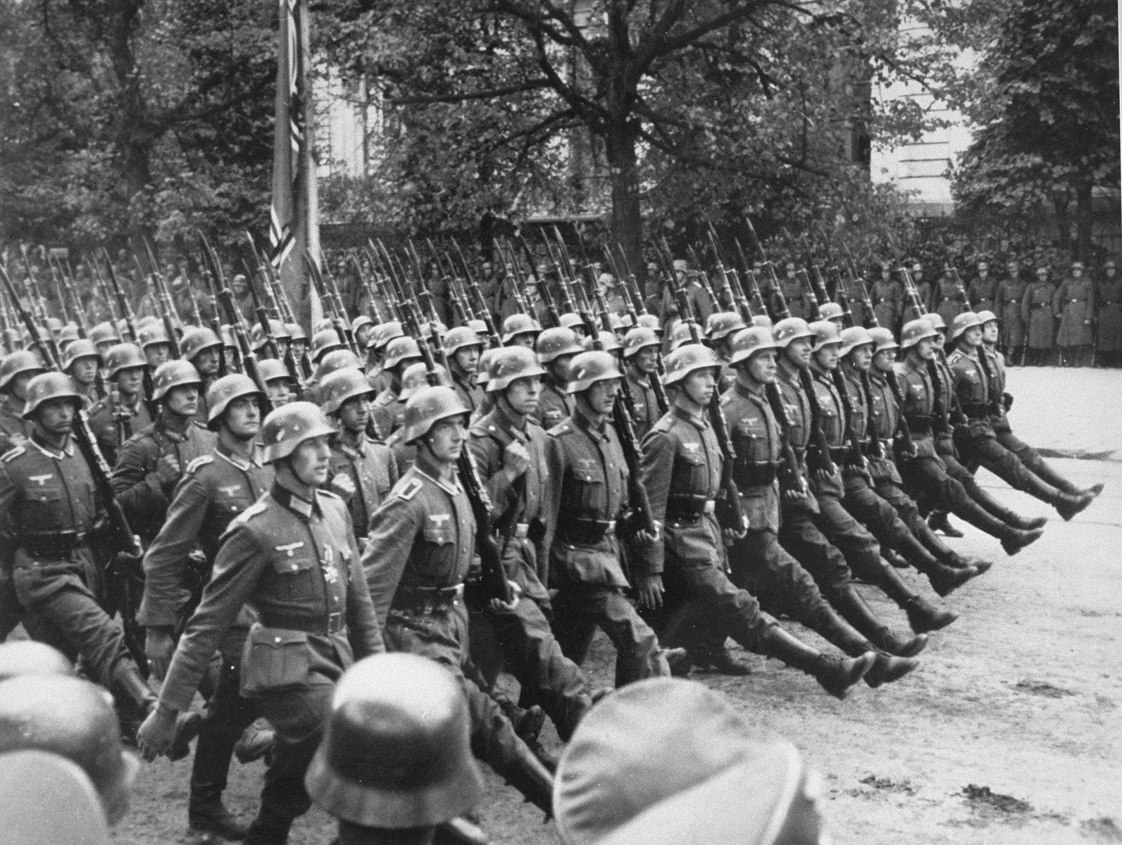 German soldiers parade through Warsaw to celebrate the conquest of Poland.