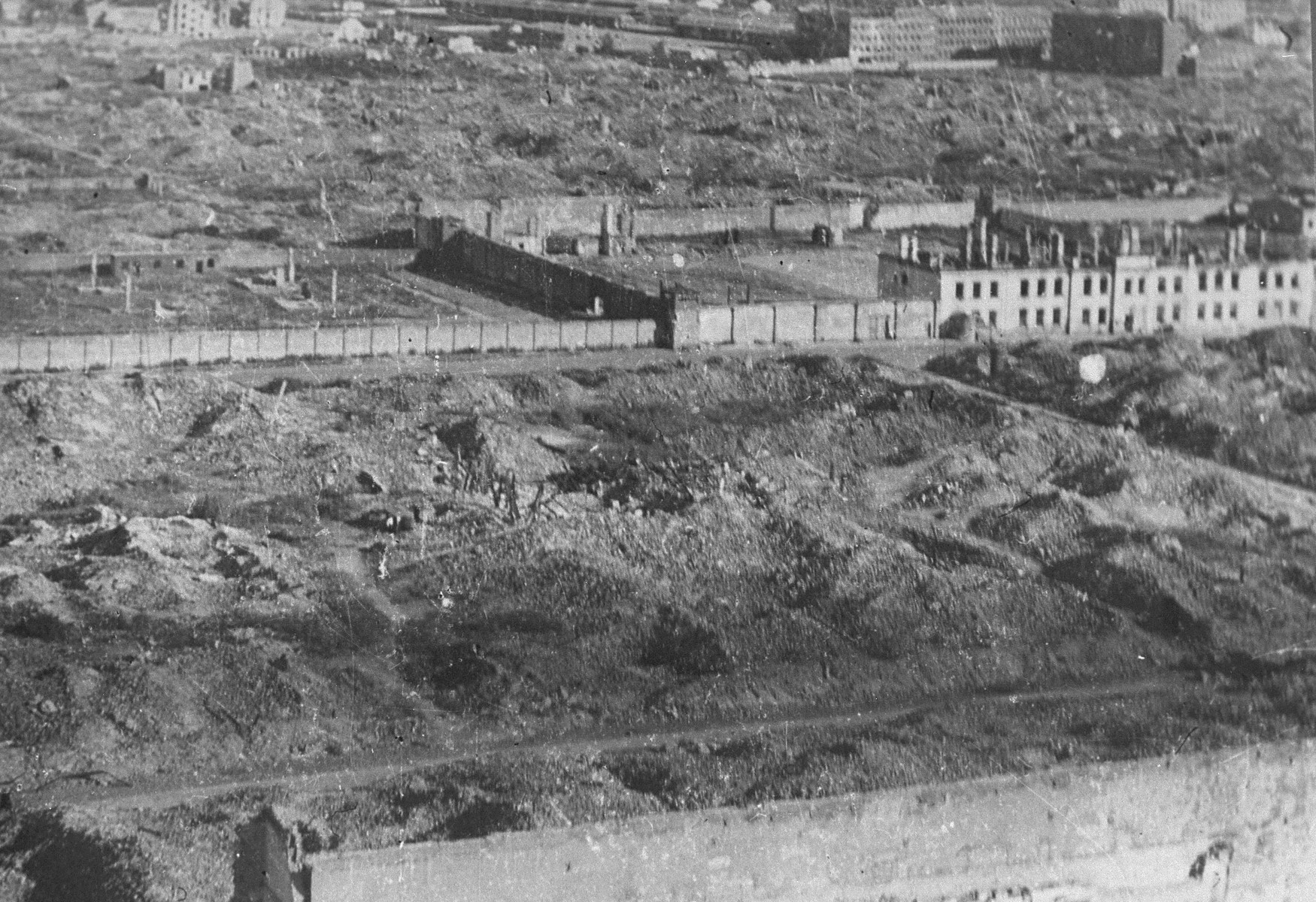 View of the ruins of the Warsaw ghetto.    Pictured in the foreground are part of the wall of Pawiak prison and ruins of buildings and warehouses on Stawki Street.