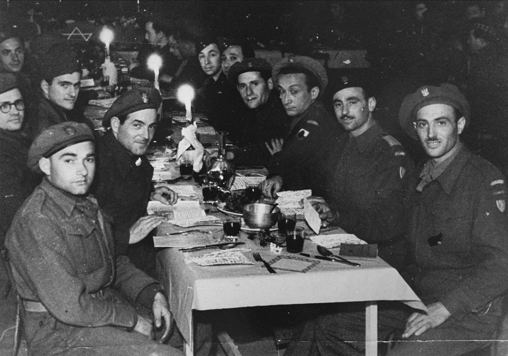 Jewish soldiers serving in various Allied armies celebrate Passover at a seder in Como, Italy.    Among those pictured is Jack Roth, a member of the Anders Army.