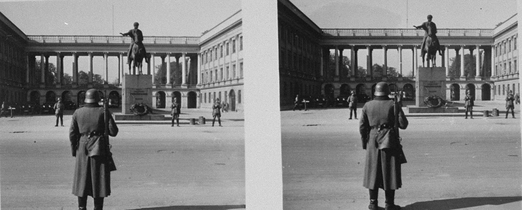 Stereoscopic photograph of German sentries standing guard outside the German occupational headquarters on the Pilsudski Platz.