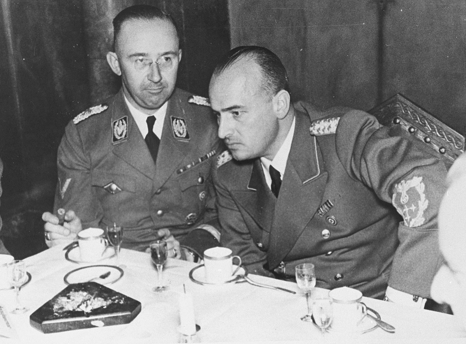 Governor-General Hans Frank hosts Reichsfuehrer SS Heinrich Himmler at a dinner held at Wawel castle during his visit to Krakow.