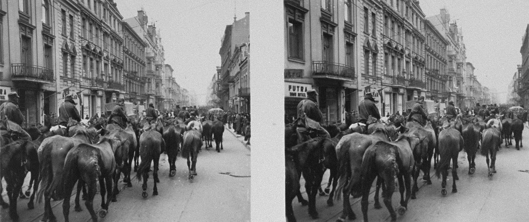 Stereoscopic photograph German soldiers driving a column of horses through a Polish town.