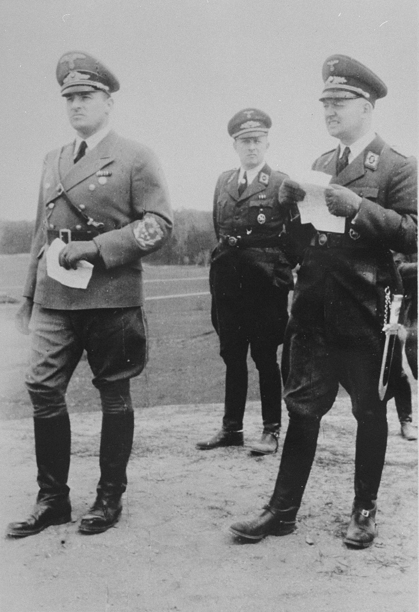 Governor-General Hans Frank accompanied by two Nazi Party officials.