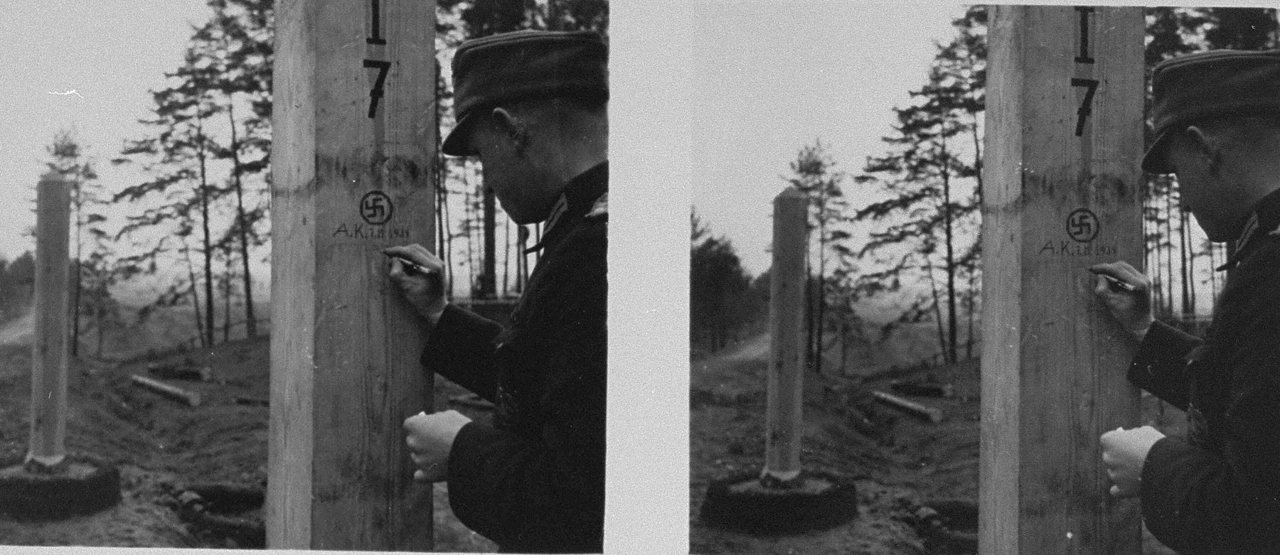 Stereoscopic photograph of a  German soldier carving his name into a pole marking the demarcation line between Soviet and German occupied Poland.