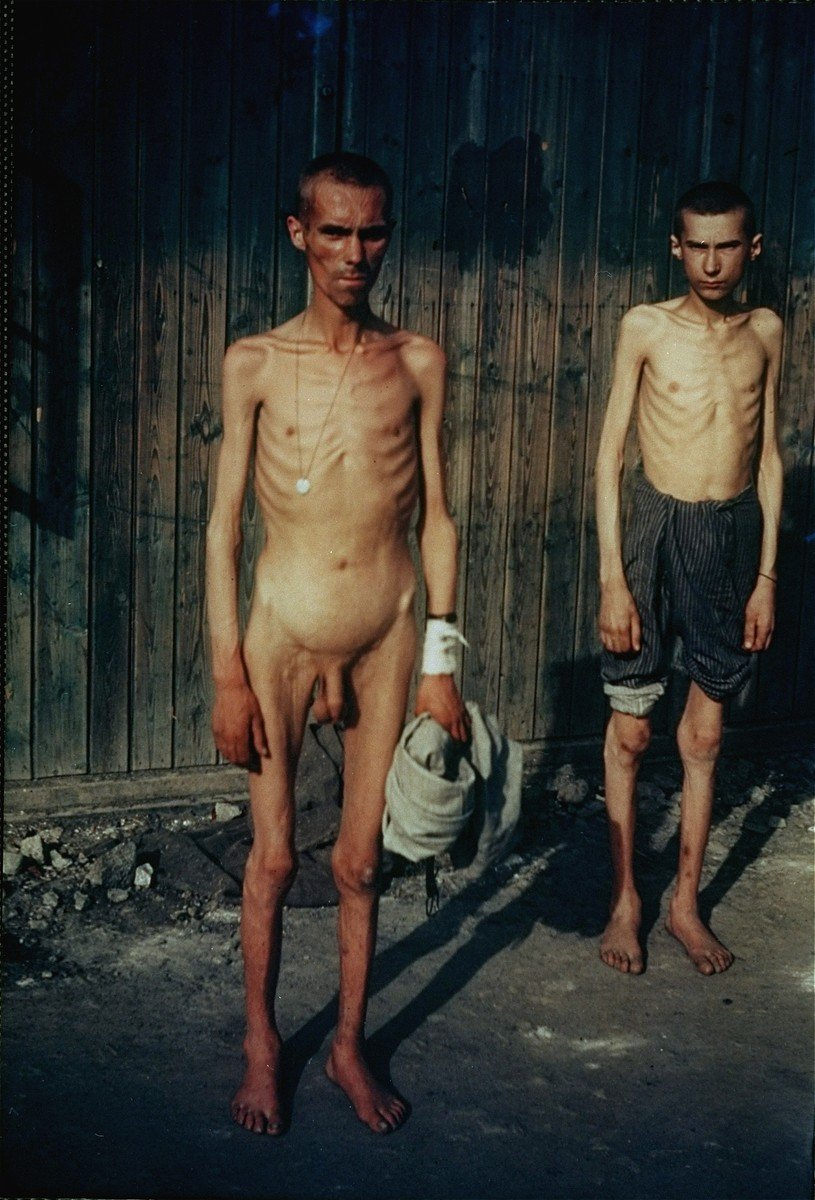 Portrait of two emaciated survivors in the Mauthausen concentration camp.