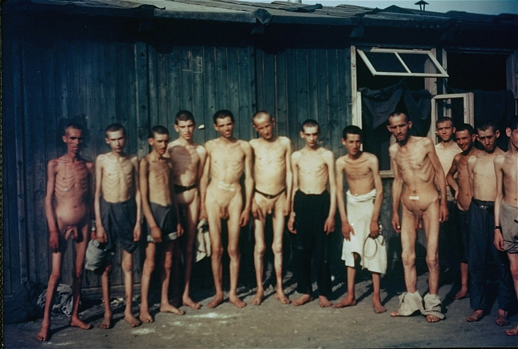 Group portrait of naked survivors in the Mauthausen concentration camp.