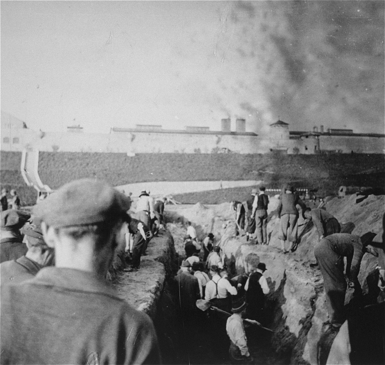 Austrian civilians prepare mass graves to bury former inmates in the Mauthausen concentration camp.