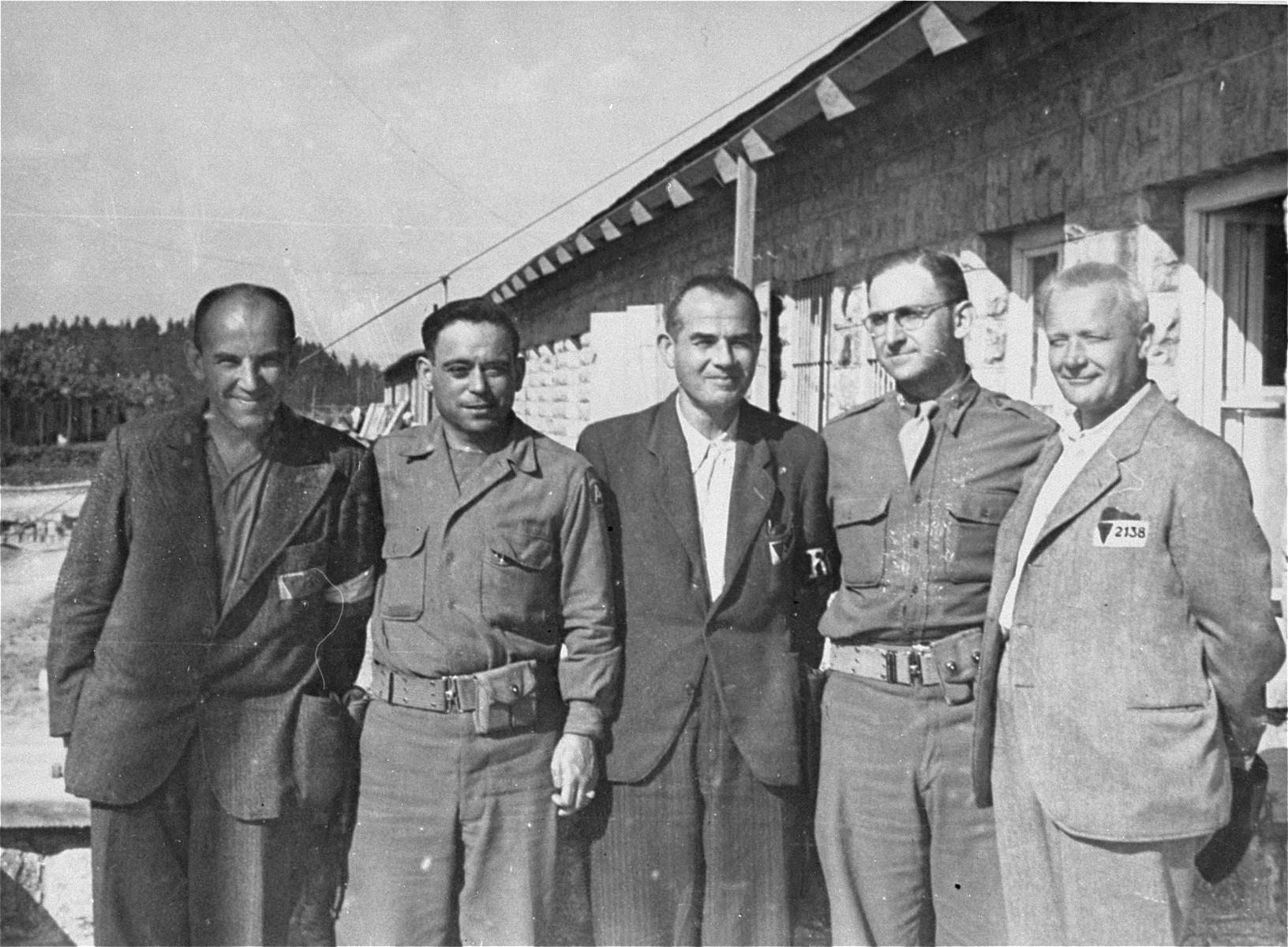 Mauthausen survivors pose with two American soldiers.  Pictured from left to right are: George Havelka from Prague; Jack Nowitz; Martin Ernor from Insbruck; Major Eugene Cohen (donor), and Joseph Ulbrecht, a former bank director from Prague.