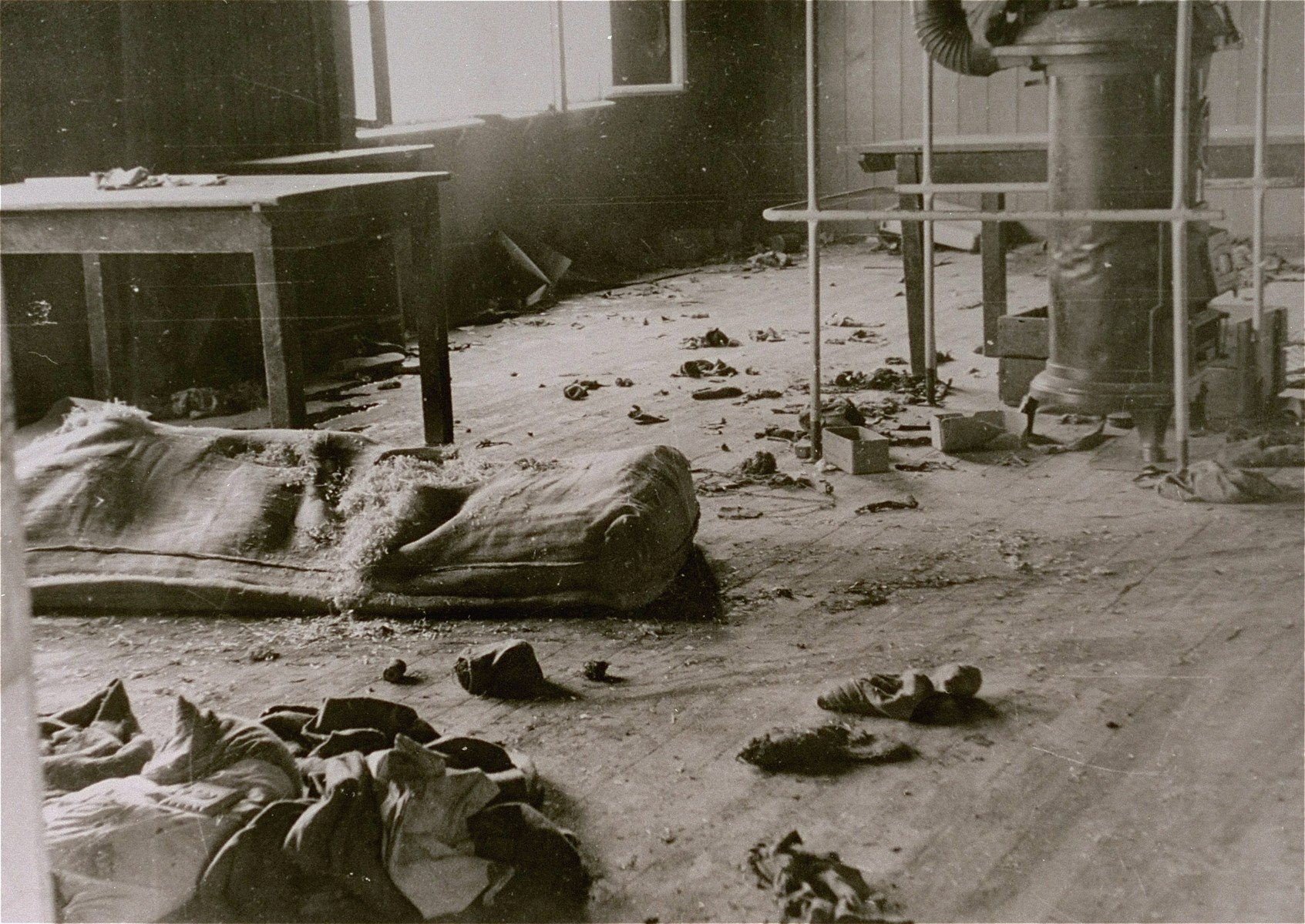 Interior view of  Block 20 of the Mauthausen concentration camp after an escape attempt.  According to the Nuremberg Trial testimony of Mauthausen survivor Francisco Boix, 700 Russian prisoners held in Block 20 attempted to escape from the camp at the end of January 1945 and meet the Red Army as it approached Yugoslavia.  Of these only 62 survived, the rest having been killed during the escape or on route to the border.