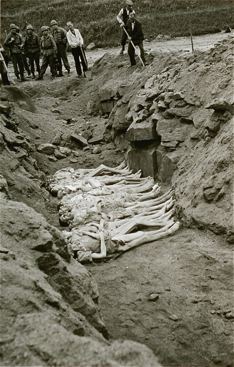Austrian civilians bury former inmates in a mass grave in the Mauthausen concentration camp.