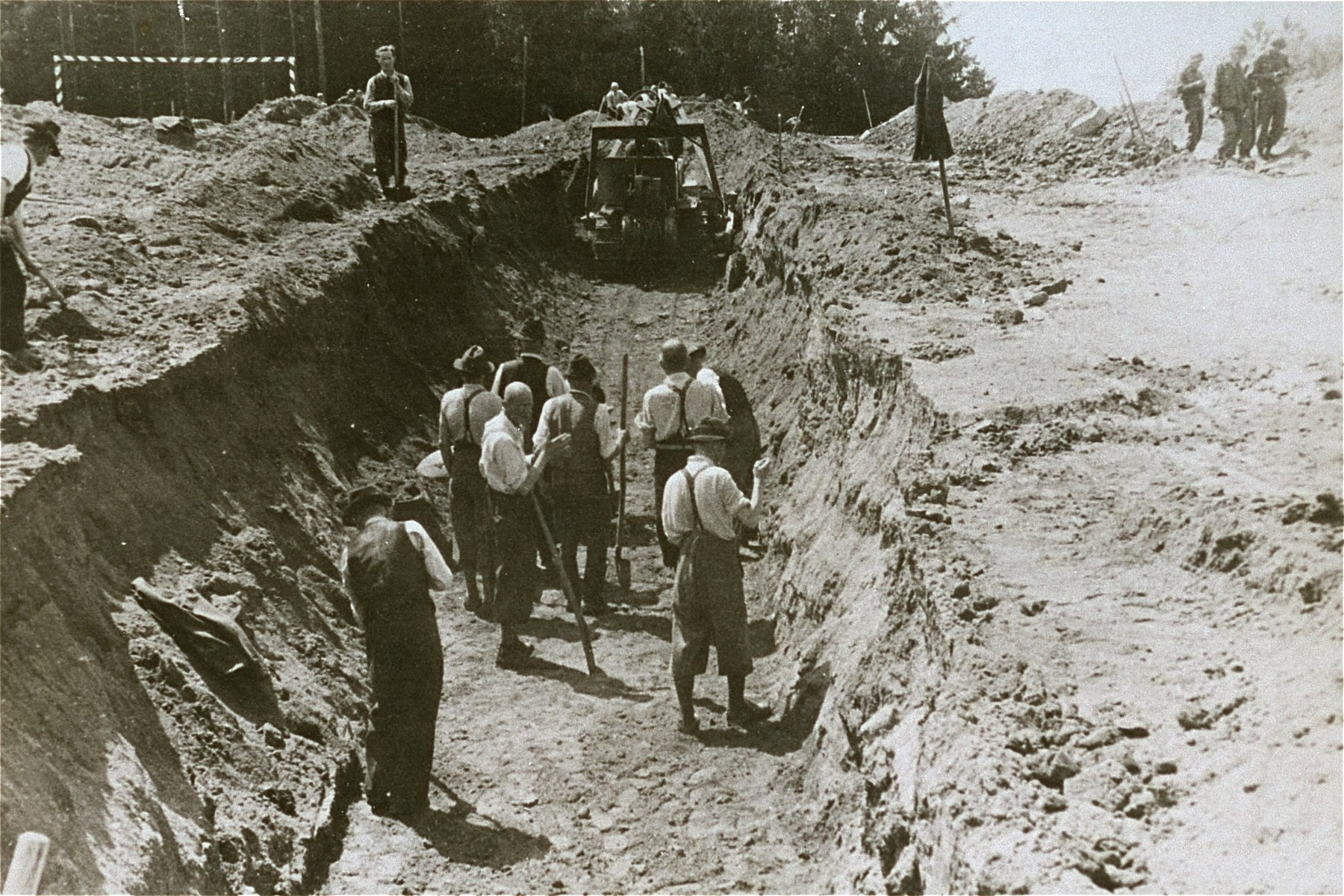 Austrian civilians prepare a mass grave to bury former inmates at the Mauthausen concentration camp.