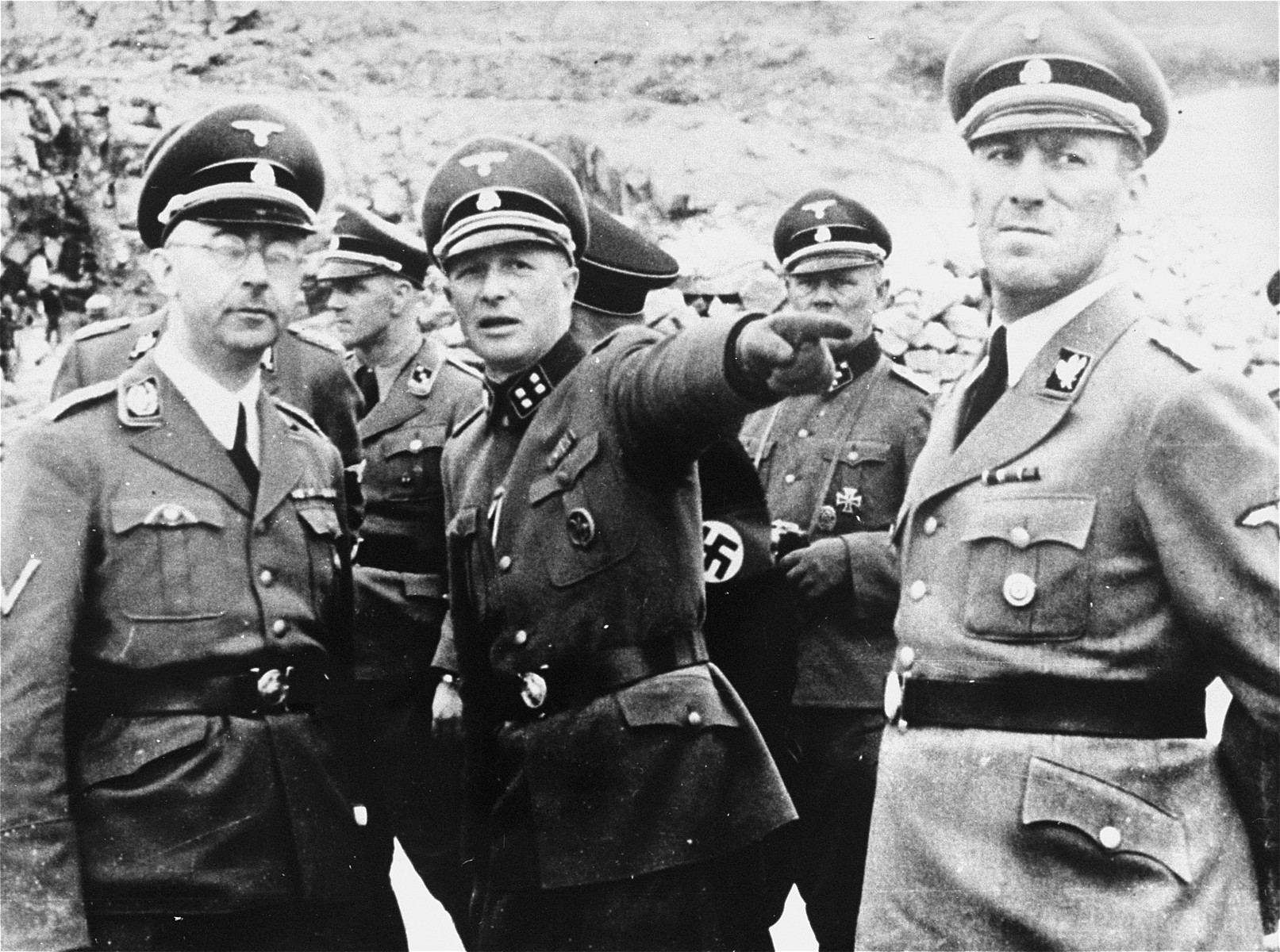Commandant Franz Ziereis points out something to Heinrich Himmler and other SS officials while viewing the quarry during an inspection tour of the Mauthausen concentration camp.    Pictured in front from left to right are: Heinrich Himmler, Franz Ziereis and Ernst Kaltenbrunner. To the right of Kaltenbrunner is Josef Kiermaier.