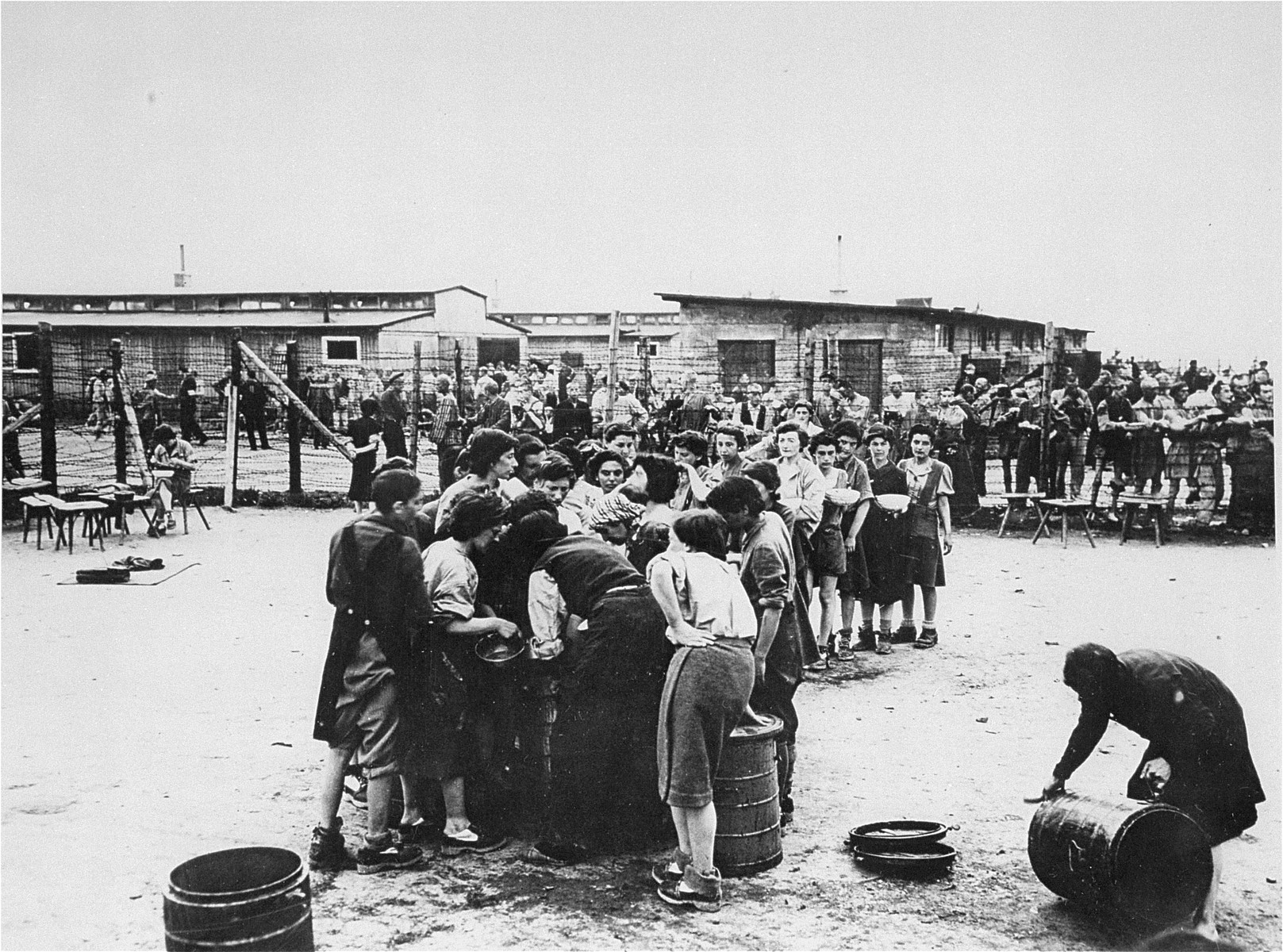 In the women's camp at Mauthausen, survivors queue up for soup.