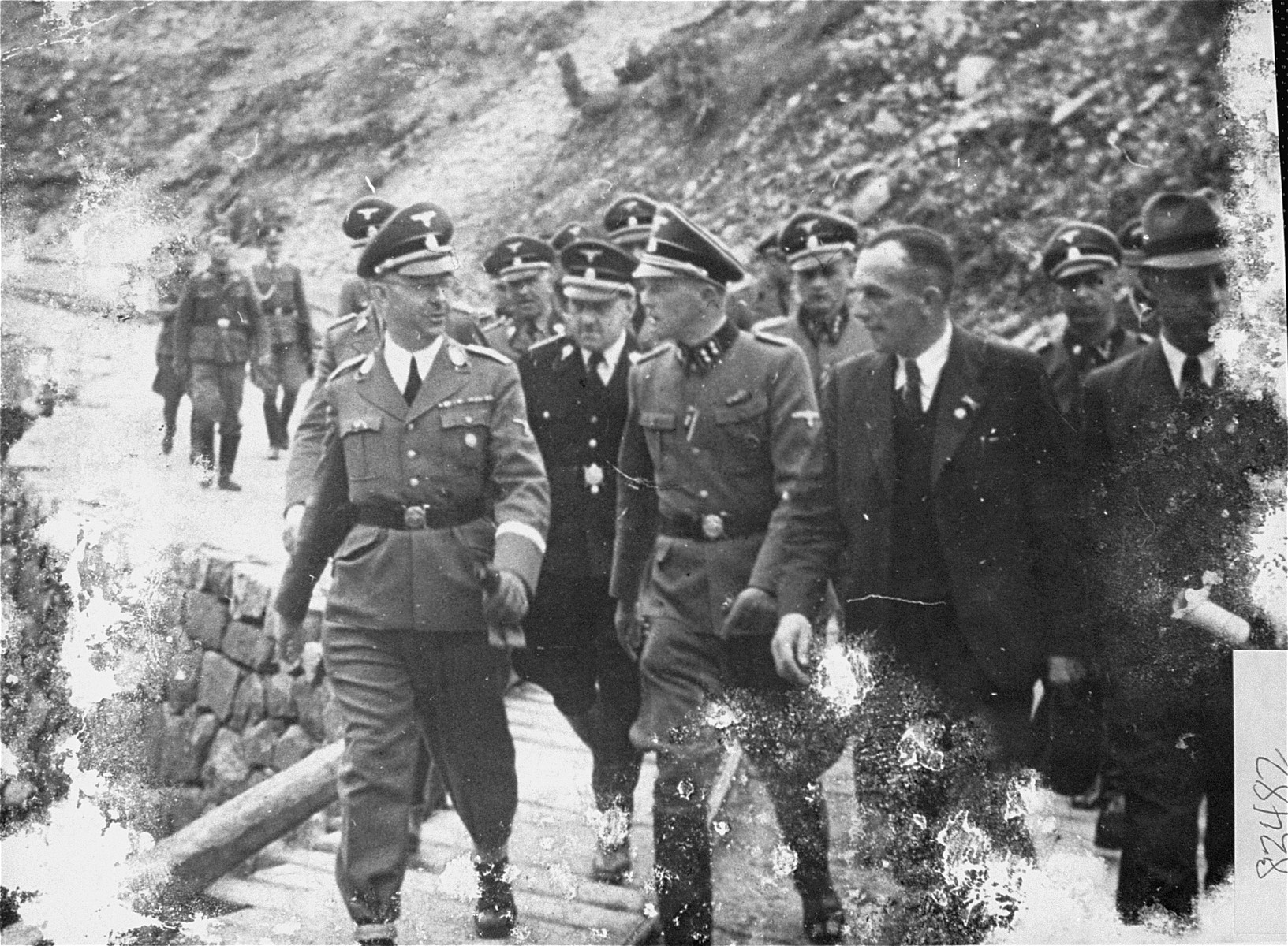 Reichsfuehrer SS Heinrich Himmler and his entourage inspect the Wiener Graben quarry during an official tour of the Mauthausen concentration camp.  Pictured in front from left to right are: Heinrich Himmler,  August Eigruber and Franz Ziereis.  Visible between and behind Himmler and Eigruber is Oswald Pohl.