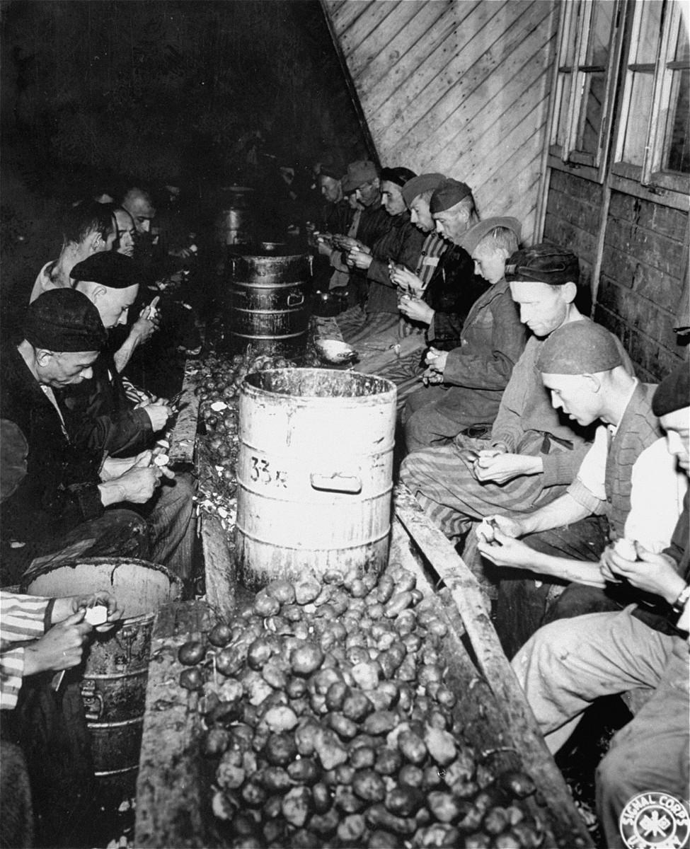 Mauthausen survivors peel potatoes.