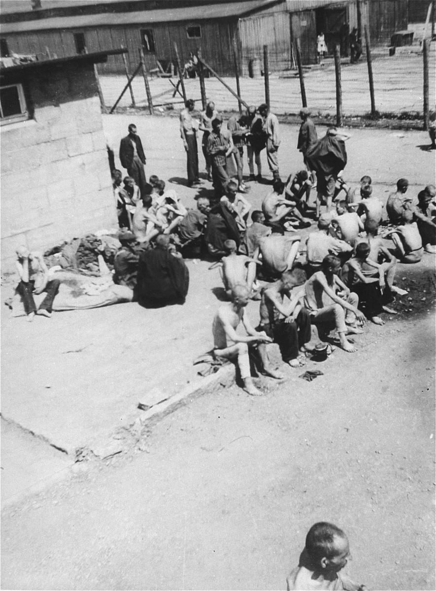 """Survivors in the """"quarantine camp"""" section of Mauthausen after liberation."""