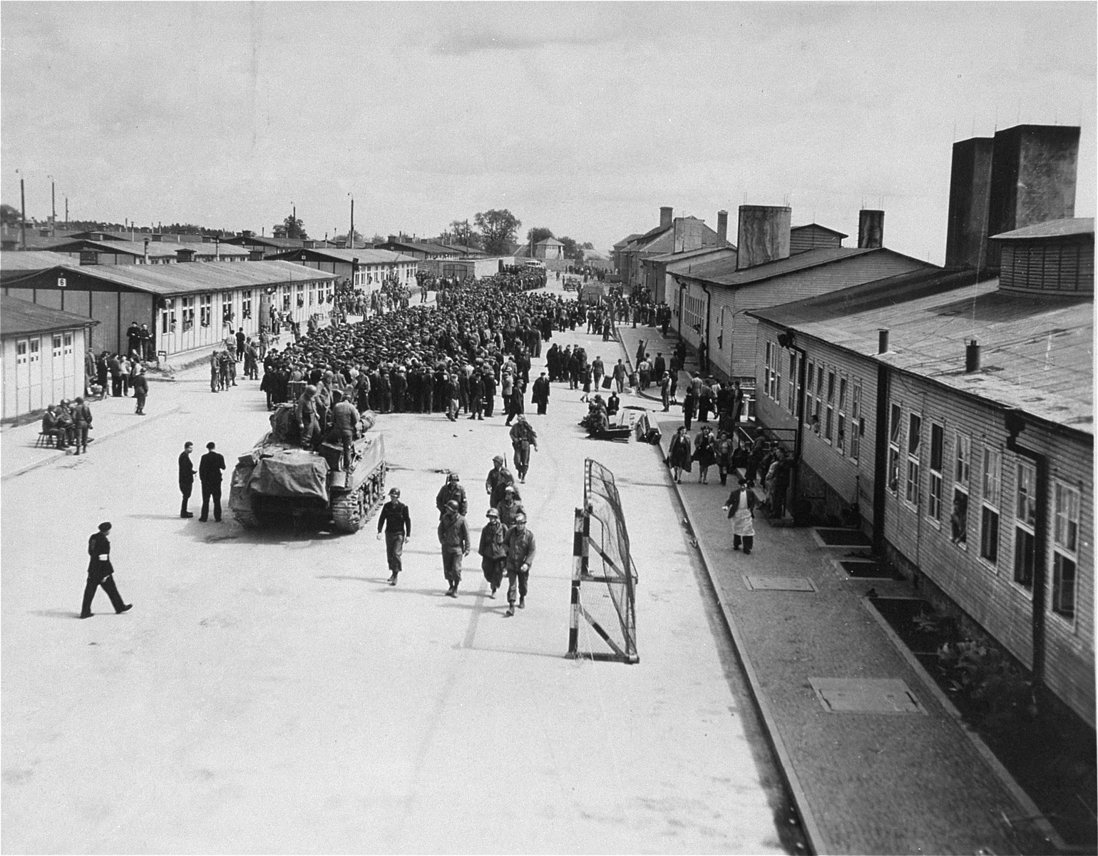 An American tank rolls down the main street of the Mauthausen concentration camp.
