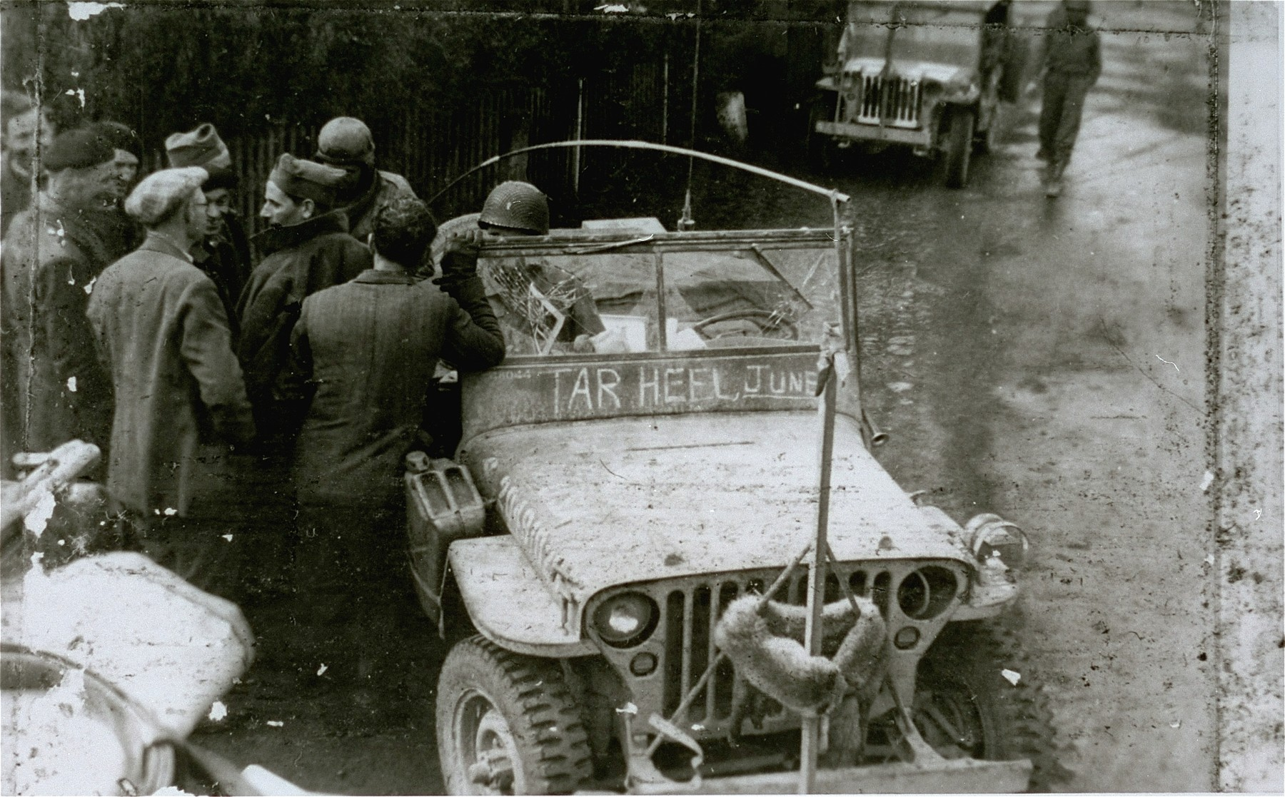 Survivors gather around an American military vehicle in the Mauthausen concentration camp.