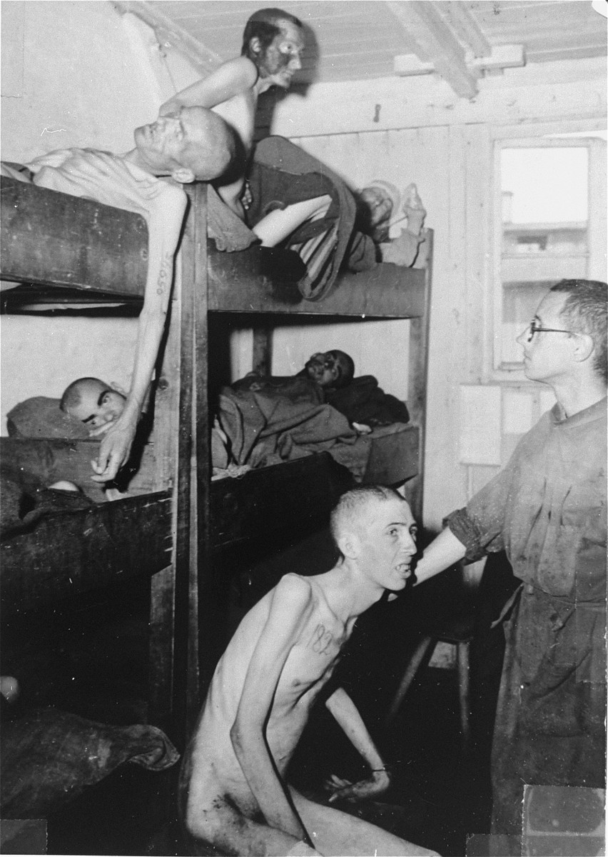 Tattooed survivors in a barracks in Mauthausen.