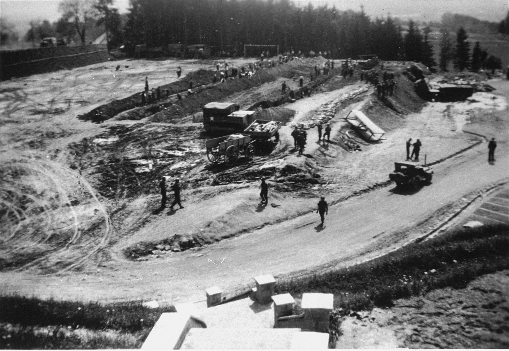 Austrian civilians prepare mass graves to bury the bodies of former concentration camp inmates at Mauthausen.