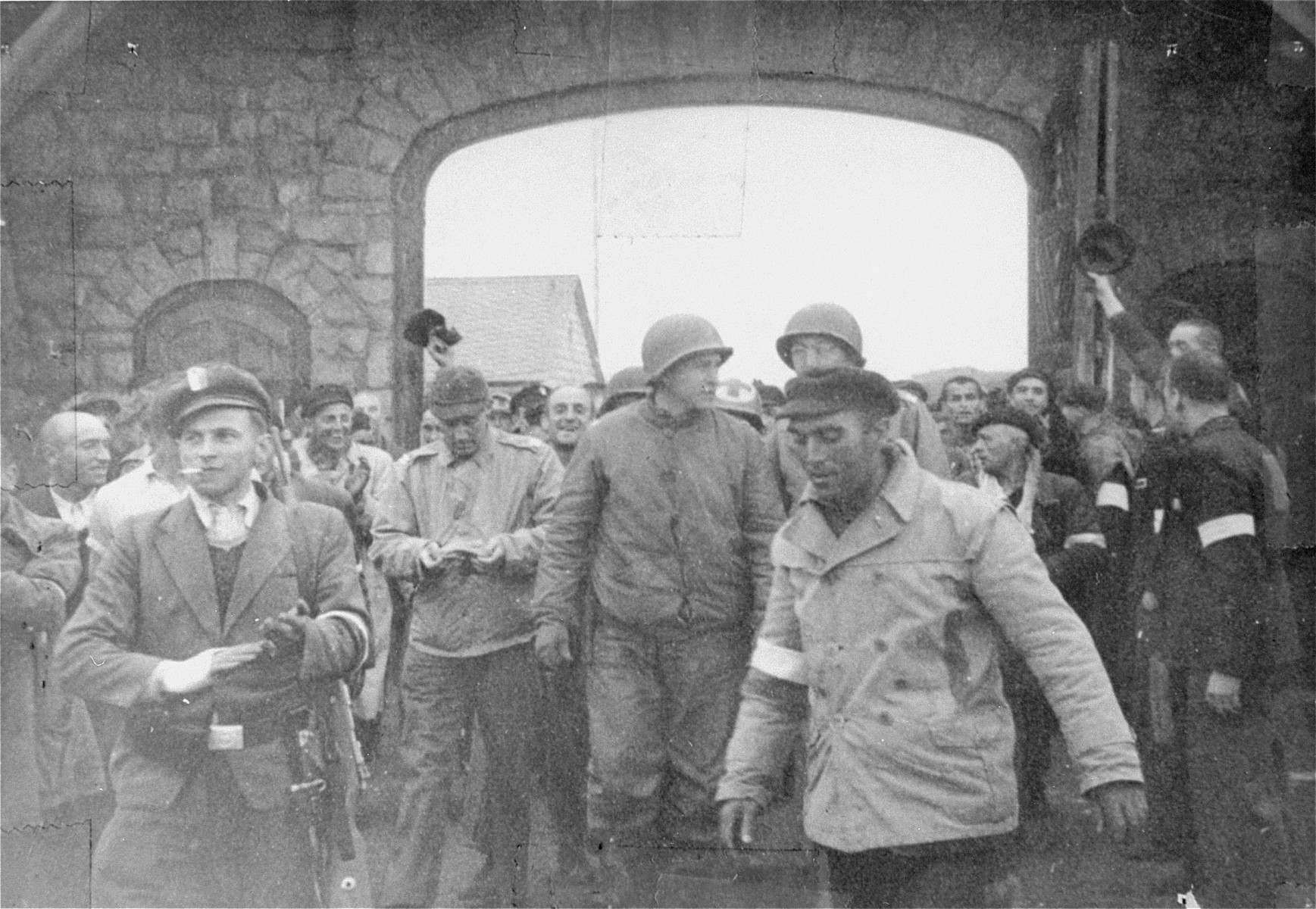 Mauthausen survivors greet American soldiers as they enter the gates of the concentration camp.