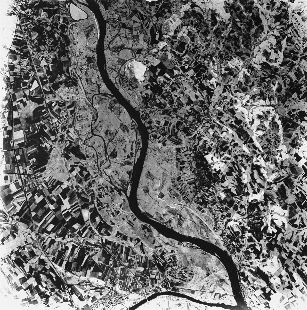 An aerial view of the Mauthausen main camp and the sub-camp of Gusen. [Oversized Photo]  Gusen is the larger camp in the center of the image.