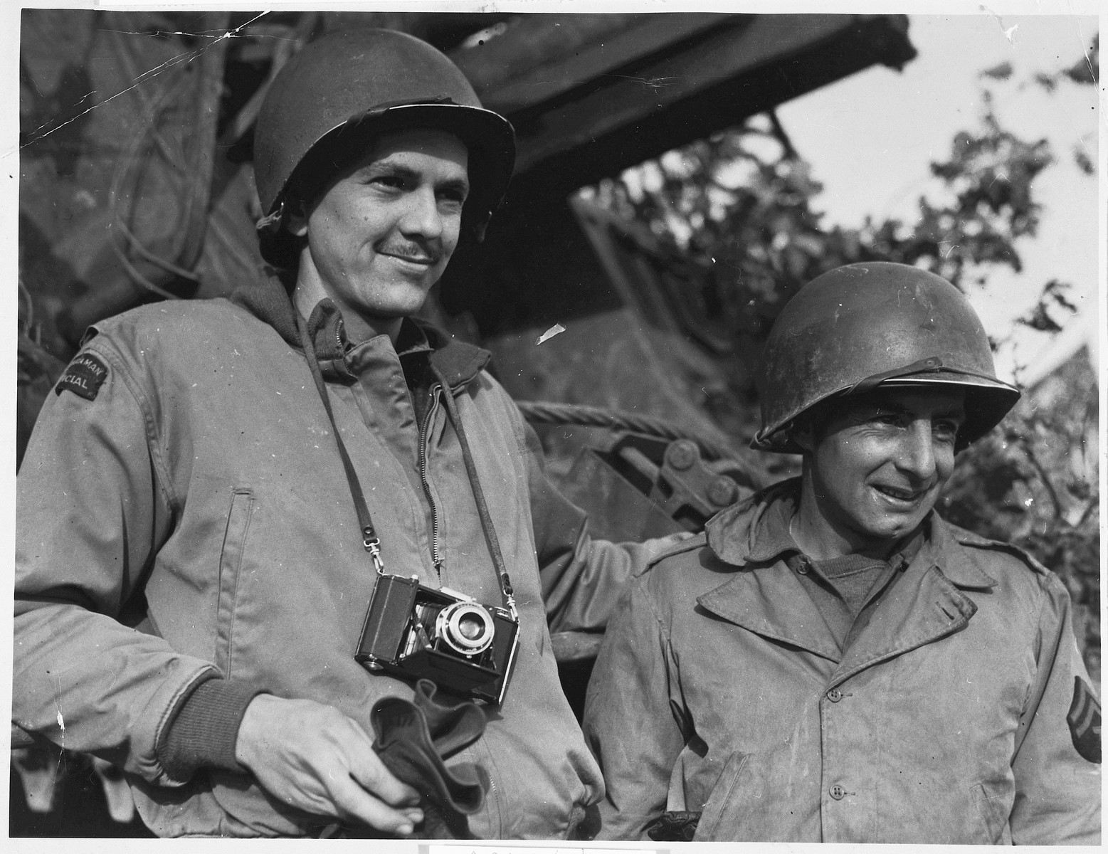 Portrait of two American soldiers from Tacoma, Washington serving in the U.S. Army in Europe during World War II.  Pictured are combat photographer, Arnold E. Samuelson (left) and Marvin R. Carter, an artilleryman attached to the same unit.