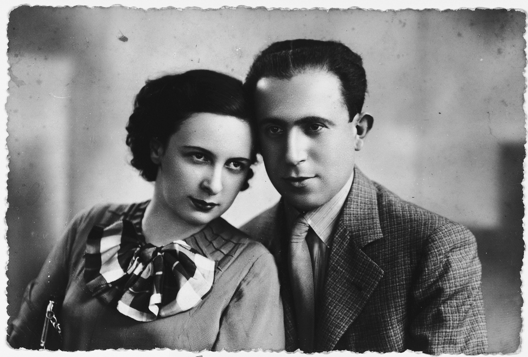 Studio portrait of a Jewish couple in Vilna.  Pictured are Hirsh and Emma Telerant.